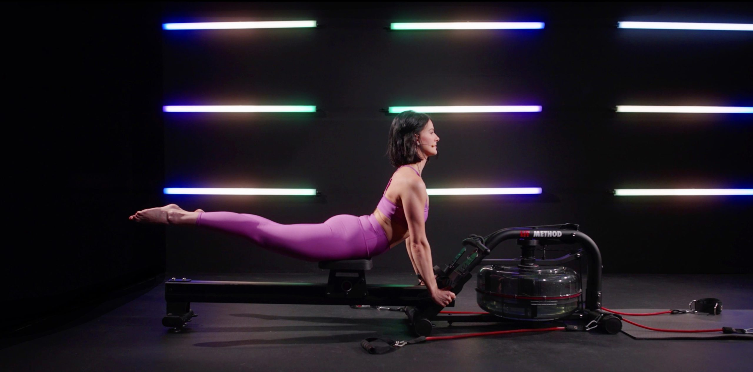 A woman doing Pilates workout on the LIT Strength Machine